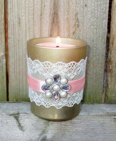Champagne Wedding / Wedding Votive Candle by CarolesWeddingWhimsy, $24.99,  set of 6, Shabby Chic Wedding - Champagne, Ivory Lace, Pink Ribbon and a Rhinestone and Pearl Charm votive candle holder.  You can find it here https://www.etsy.com/listing/203525330/champagne-wedding-wedding-votive-candle