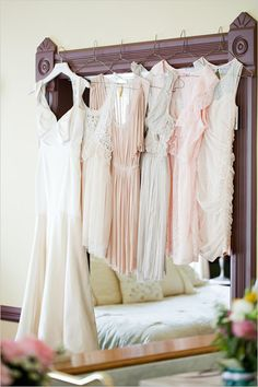 Bridesmaid dresses hanging with the bridal gown, calming colors