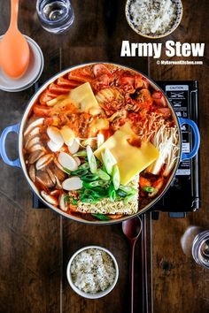 Jjigae (Army Stew) Korean army stew (Budae Jjigae) is a Korean fusion hot pot dish loaded with Kimchi, spam, sausages, mushrooms, instant ramen noodles and cheese. The soup is so comforting and addictive! Korean Side Dishes, Budae Jjigae Recipe, Best Korean Food, South Korean Food, Korean Kitchen, Asian Recipes, Ethnic Recipes, Easy Korean Recipes, Asian Cooking
