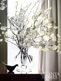 Tall, elegant branches in the foyer reach up to the high ceilings.