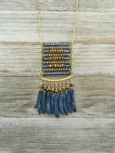 Crystal beaded necklace with blue coral. The chain is gold plated brass with a hook and eye clasp. The necklace is approximately 22 in length with a 1 extender.