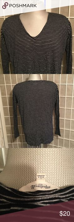 Madewell Rayon Loose Top Just Washed Oversized This is a Madewell Top just washed so it's a bit wrinkly bc its rayon, once it's on it looks great but rayon is a natural fiber and can stretch and wrinkle, its a classic lightweight long sleeve top in black with grey stripes Recent line great condition. Madewell Tops Tees - Long Sleeve