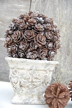 outdoor decor for winter..attach pinecones to large styrofoam shape of your choice, tip the ends with silver or white spray paint or fake snow...place in summer urn. Looks great indoors or outdoors