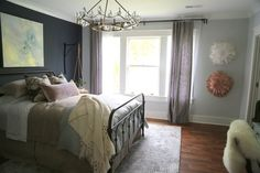 One of my favorite rooms was this bedroom painted in Benjamin Moore paint colors, Wickham Gray HC-171 and Hale Navy HC-154. The wall the bed is on is one of the few places I approve of an accent wall, and this one is lovely!Benjamin Moore Paint Colors in the 2016 O'More Designer Showhouse - The Decorologist