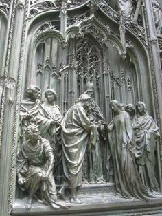 Milan Cathedral. Detail from main bronze gate.