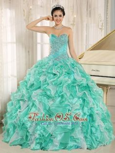 Turquoise Beaded Bodice and Ruffles Custom Made For 2013 Quinceanera Dress In Anderson California  http://www.fashionos.com  This fantastic apple green quinceanera dress features a fitted bodice with ruching and exquisite rhinestones. The flirty skirt in luxurious tulle is voluminous with swirling tiers of ruffles in multiple colors for a festive look. A lace up corset style closure in the back secures the dress in place. So gorgeous and perfect! You are the Queen in the dance floor.