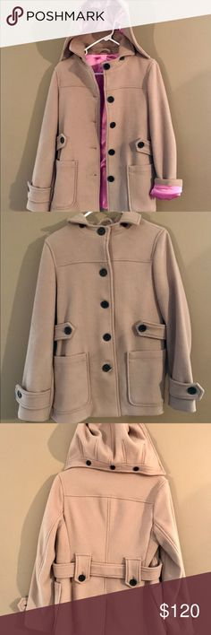 A Tan Wool Jacket (Pea-Coat) with pink lining It's A Tan Wool Jacket (Pea-Coat) with pink polyester lining. The hood of the jacket, also outlined in pink is removable via Buttons.  It's a super stylish, feminine jacket.  The jacket is in great condition, not one bottom missing or loose, as a matter of fact the extra buttons are still sewn on a tag into the lining of the Jacket.  I want to keep it, it's just a size to small!!  Please message me for questions & offers!!  ❤️❤️ GAP Jackets…