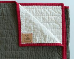 I've always greatly admired whole cloth quilts. I love their minimalist non fussy look, and I especially love that the stitching is what makes these quilts. And, after planning and plotting for way