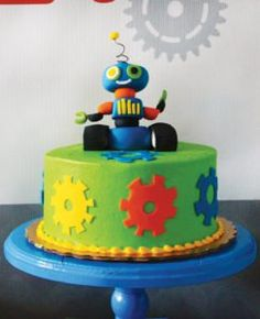 gear cake with robot topper for a birthday party