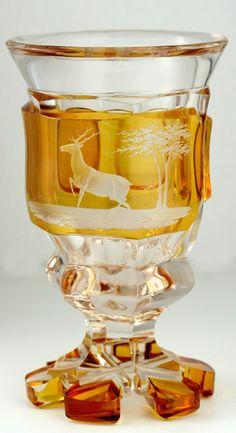 Antique Amber Glass. Bohemian amber flashed split toe goblet engraved with a stag and trees, c.1900