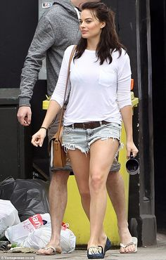 Back to her Gold Coast roots: Robbie channeled her inner beach babe in a tiny pair of denim hot pants on Saturday