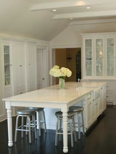 kitchen table integrated into island, great website too for casual room decor