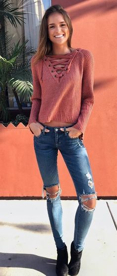 cute fall outfit idea : lace up sweater + ripped jeans + boots