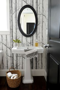 This mirror is a better size for above the pedestal sink. Also - a bold wallpaper is fun in a small space like a powder bath. Something to consider. Cole & Sons Woods Wallpaper