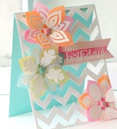 Birthday Vellum PapertreyInk; Sponge ink backside of vellum for color, emboss front. Chevron Vertical die Cover Plate over a piece of Clear CS (back made from Aqua Mist CS). Flowers: Lovely Layers Die; Stamps: Round Repeats, Bigger Blooms & Live Love Life.