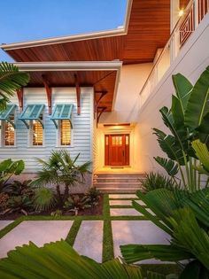 HGTV loves the exterior of this island-style home with blue Bahama ...