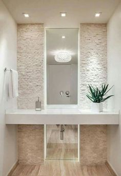 white and stone bathroom/mirror floor to ceiling/white floating vanity