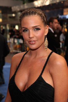 Blonde English glamour Danielle Lloyd wearing a black dress at London opening of Transformers