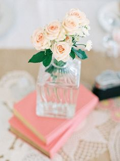 Vintage Book Centerpieces, could get vintage love stories or fairy tales super cheap in your wedding colors, and either give them out to your guests or have them write in them for you to keep. So unique and special!