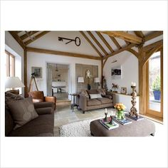 Country living room with vaulted ceiling