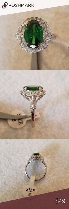 Antique Style Lab Created Emerald This ring looks like it came right of an estate auction. The oval shape lab created emerald is set on solid sterling silver and embellished with simulated diamonds. See pics for 925 stamp and details. Jewelry Rings