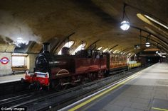 Steam train returns to London Underground for the first time in a century to mark 150 years since the Tube was opened
