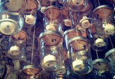 Jars, tealight candles, string. Hang the lit candles in jars, great decoration for a garden party or summer barbeque..