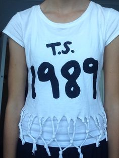 I made this taylor swift top just some fabric paint and a stencil off the internet and scissors to cut the tassels <3 Fav top!!!