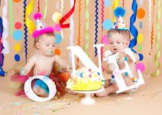 Twins first birthday smash cake photo session  Used letters from hobby lobby spray painted white. Background is ribbon curled with curling iron & circles are made of construction paper.