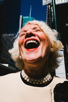 Eric Kim Interview Street Photography. I really like this image as it is really up close to the woman face so you can see the detail in what she's wearing and see clearly that she is laughing where as if it was further away it would've been difficult to tell what she was doing.
