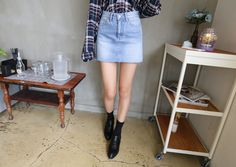 A simple denim skirt is turned into a chic and feminine piece.