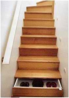 storage space via stairs that are/have drawers
