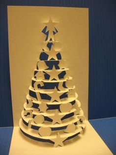 I know its not Christmas, but I love these designs!  Kirigami - X'mas Card
