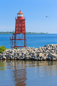 Racine, Wisconsin North Breakwater Lighthouse with Wind Point Lighthouse on the distant horizon. Photographed by Kenneth Keifer.