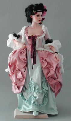 """Raphaela, a porcelain doll by Silvia Opderbeck. She has a hand knotted wig & German glass eyes. Her gown is 18th centrury """"à la Polonaise"""""""