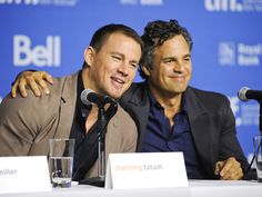 Hug it out, guys! Channing Tatum leans in as he and costar Mark Ruffalo, who play brothers in their new film, Foxcatcher, take questions about the drama during a Monday press conference at the Toronto International Film Festival.