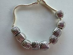 Antique Silver Euro/Leather Wave Beads on Etsy, $5.00