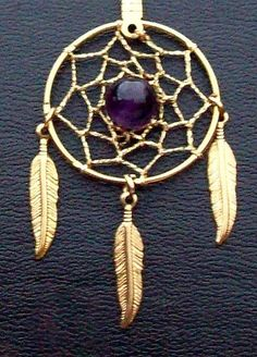 This is amazing! Amethyst in the middle makes this dream catcher pendant/necklace so unique! $9