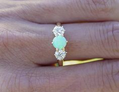 opal and diamond ring! (maybe diamond with opals on the sides?..just sayingg)