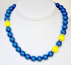 Hey, I found this really awesome Etsy listing at https://www.etsy.com/listing/102839669/blue-pearl-necklace-and-yellow-handmade