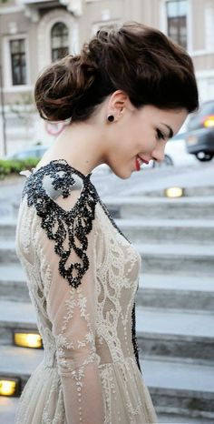 Exquisite Valentino lace gown with shoulder details.