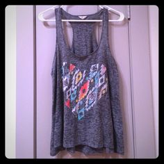 "Aztec Tribal Gray Racerback Tank Casual gray racerback tank with heart-shaped Aztec or tribal print. Fits more like a flowy medium. By the ""I Love H81"" brand at Forever21. Easy breezy and perfect for concerts, summer days, or general every day wear! Excellent condition. Forever 21 Tops Tank Tops"