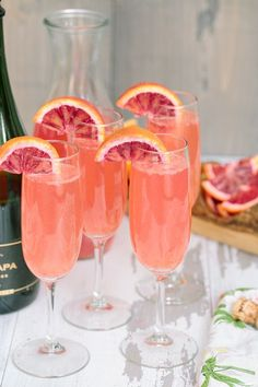 Lemonade mimosas with blood orange liqueur.