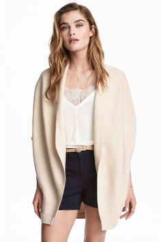 Rib-knit cardigan in a soft cotton blend with no buttons. Draped lapels and dolman sleeves with ribbed cuffs.
