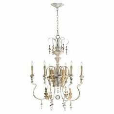 "6-light iron and wood chandelier with leaf detail and drop bead accents.  Product: ChandelierConstruction Material: Iron, wood and glassColor: White and goldAccommodates: (6) 60 Watt candelabra bulbs - not includedDimensions: 31.5"" H x 24"" Diameter"