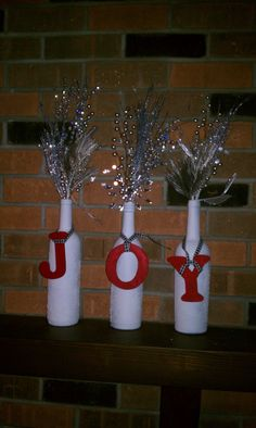 DIY Wine Bottle Christmas decor - for me, a little more rustic and without the letters, but like the bottle and limb concept