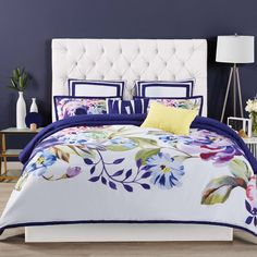 A modern over scale painterly floral engineered pattern bringing elements of nature indoors with a vibrant colour palette of indigo blues, fuchsias and placed on crisp white ground with accents of dandelion yellow. A variety of treatments and techniques including fabric manipulation and embroidery are used on the separately purchased accessory decorative pillows and shower curtains. Duvet and shams face fabric is 100% microfiber polyester.