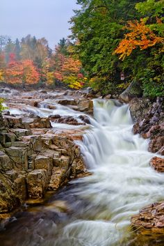 A vibrant fall scene at Rocky Gorge on the Swift River in the White Mountains of New Hampshire. Brilliant fall foliage can be seen on the far bank above the swiftly flowing whitewater crashing through the gorge while a misty fog hangs in the air. Photography 101, Amazing Photography, Landscape Photography, Better Photography, Digital Photography, Beautiful World, Beautiful Places, Beautiful Live, Wonderful Places