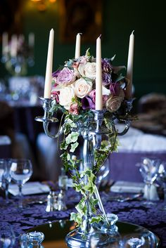 Candelabra with calla lilies and roses