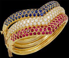 Van Cleef & Arpels 18k. Gold 3pcs. Bangle Bracelets.1pc. ruby bracelet approx. 4.34cts.1pc. sapphire bracelet approx. 4.36cts.1pc. diamond bracelet approx. 5.28cts.Circa 1980s